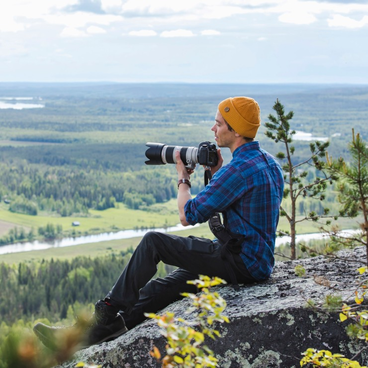 The lead instructor, Harri Tarvainen, on a fell top capturing the beauty of Lapland's summer.